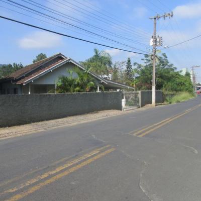 Terreno Urbano com Casa Mista